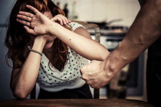 Woman Covering Her Face In Fear Of Domestic Violence