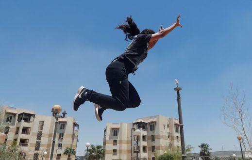 """Mariam Emad from Parkour Egypt """"PKE"""" practices her parkour skills around buildings on the outskirts of Cairo"""