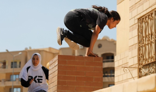 "Egyptian women from Parkour Egypt ""PKE"" practice their parkour skills around buildings on the outskirts of Cairo"