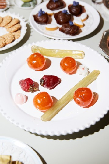 Candied strawberries, oranges and celery for dessert. Two tiny sugar flowers, picked up at the Milan pastry shop Cucchi, also adorned the plate.CreditPaul Quitoriano