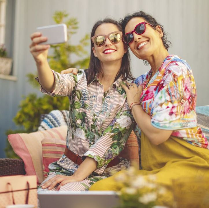 mother-and-daughter-are-taking-selfies-royalty-free-image-1091417128-1553267244